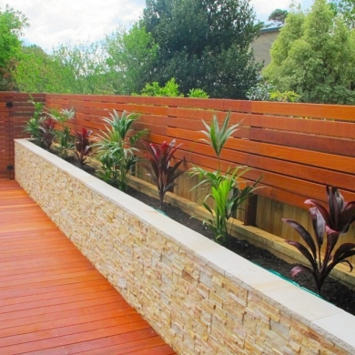 Decking with stone veneer plant box