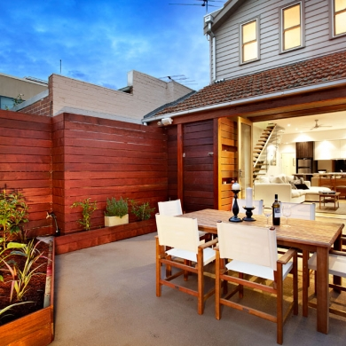 Outdoor dining area with timber slat fencing