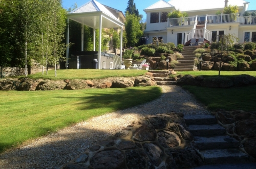 Multilevel backyard with stone retaining walls