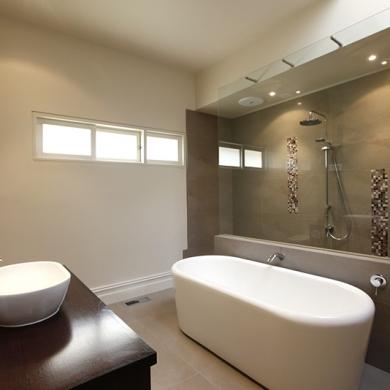 Sleek wet room with a bath