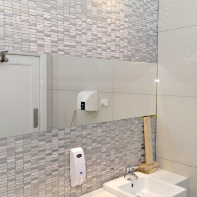 Bathroom with mosaic tiled accent wall
