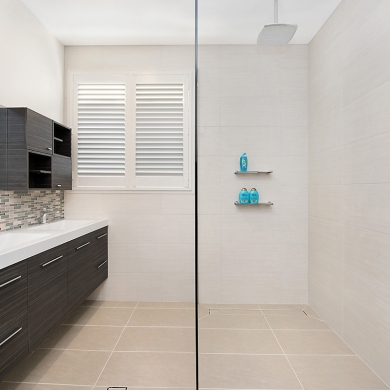Modern bathroom equally divided by a shower screen