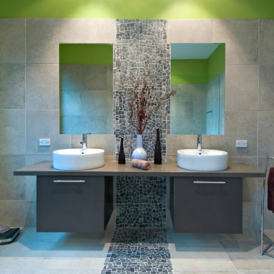 Double vanity with stone tile accent