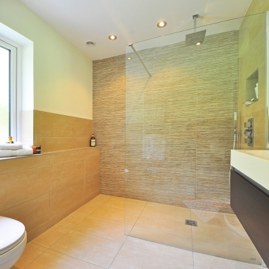 Large wet room with rain shower and frameless shower screen