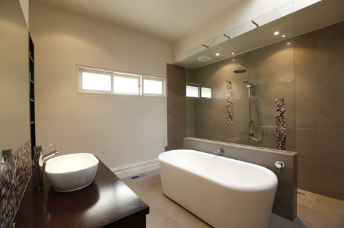 Sleek wet room with a bath