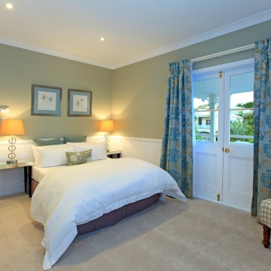 Fully carpeted and well-lit bedroom