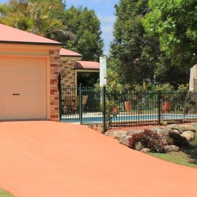 Eye-catching coloured concrete driveway
