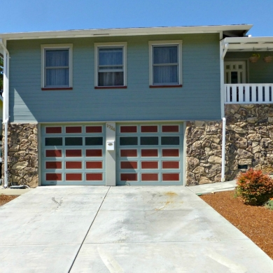 Two-car garage with colourful doors