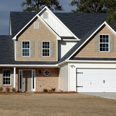 Attached garage with windowless carriage house garage door