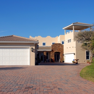 Large garage and brick driveway