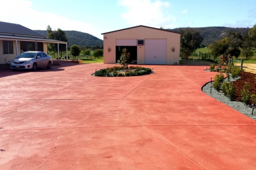 Coloured concrete driveway and detached two-car garage