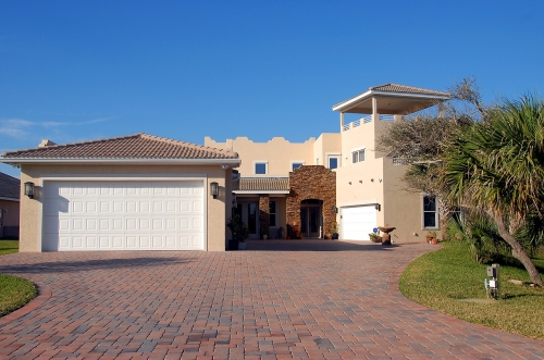 Large garage and brick driveway