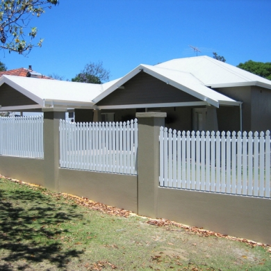 Freshly painted concrete and picket fence