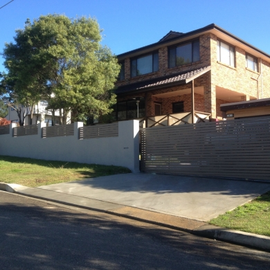 Slat fencing as accent to a concrete wall