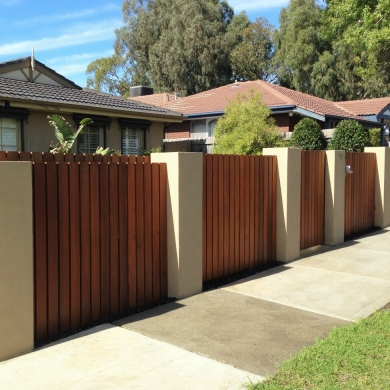 Timber fence and solid concrete pillars