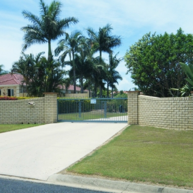 A combination of brick and wrought iron fencing