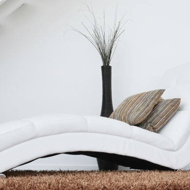 Classy white chaise lounge chair