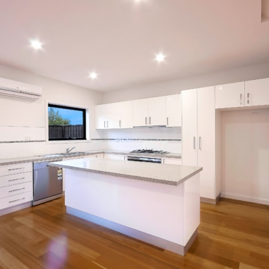White kitchen with wood vinyl flooring