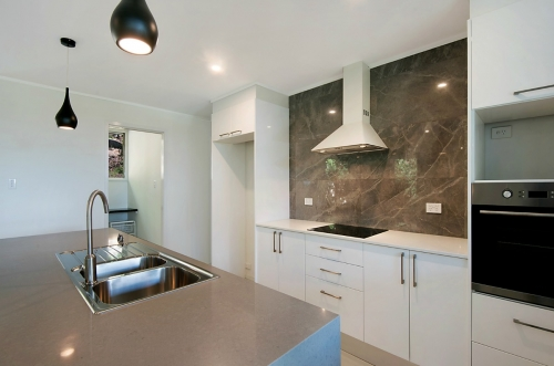 Stone kitchen bench top and marble splashback