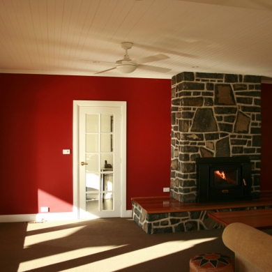 A red feature wall to improve the ambiance of the room