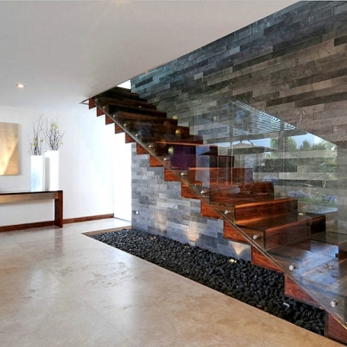 Straight floating stairs with frameless glass railing