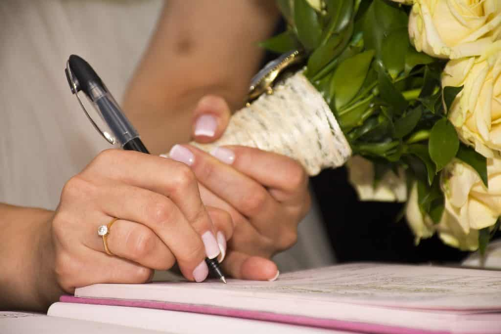 signing the marriage register and certificates