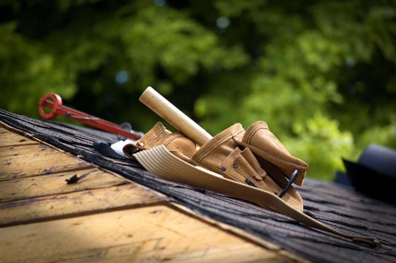 Roof repair work tools on roof