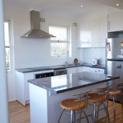 The kitchen was revamped with sleek, stainless steel appliances and a marble benchtop