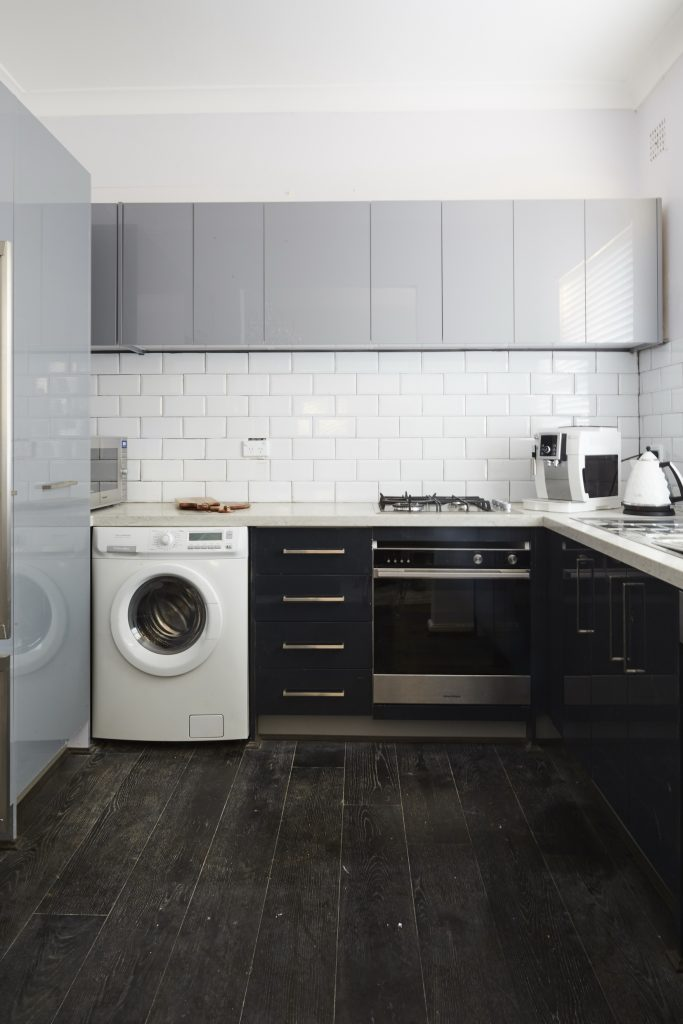 Tim & Cody incorporated a laundry into their Manhattan style kitchen