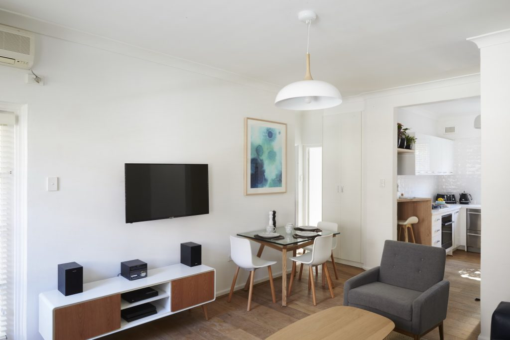 The Scandinavian Chic style apartment had a colour palette of white, pale wood and blue