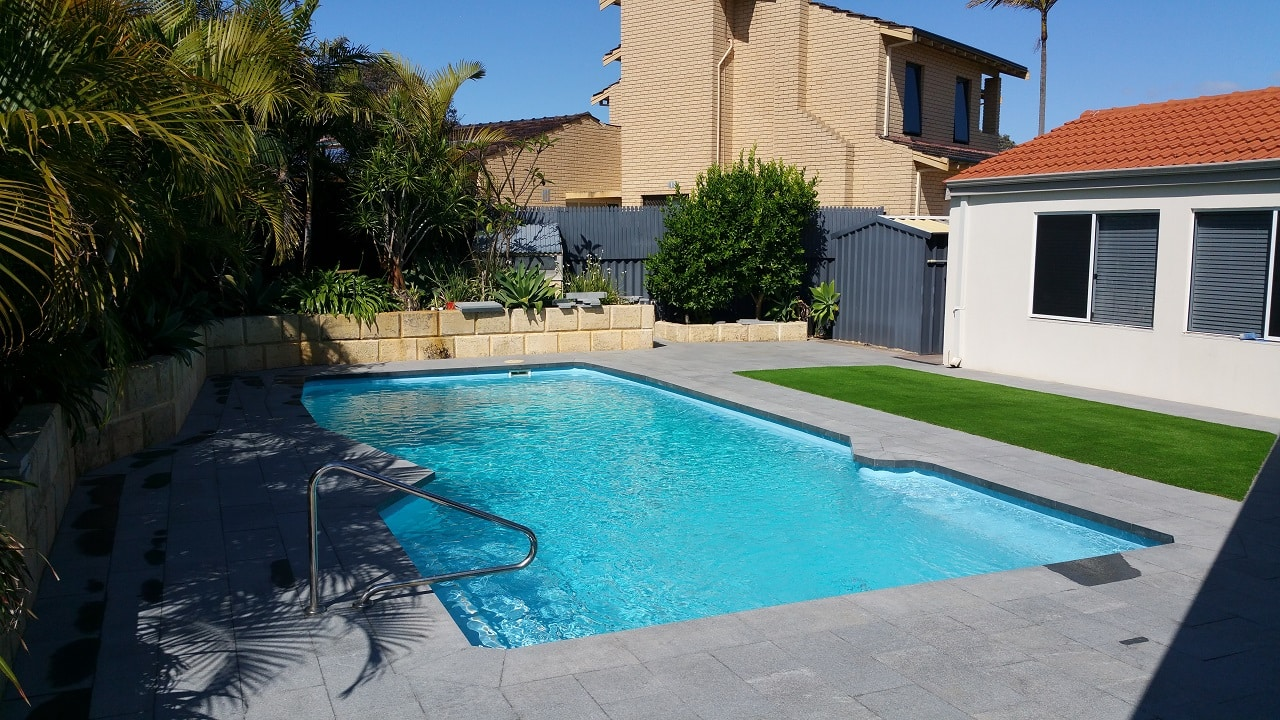 Paved in ground swimming pool area