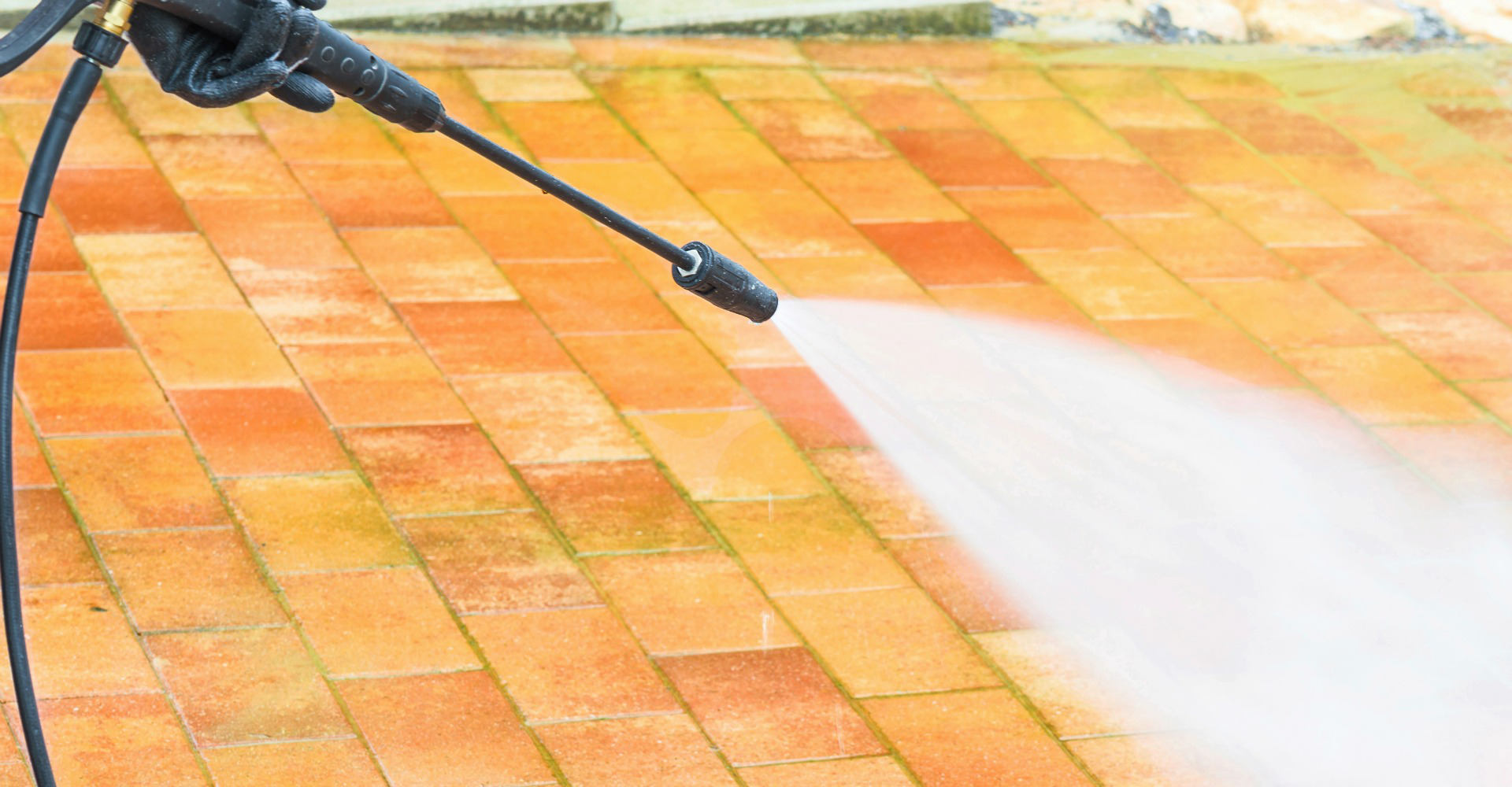 Pressure cleaning outdoor floor with high pressure water jet