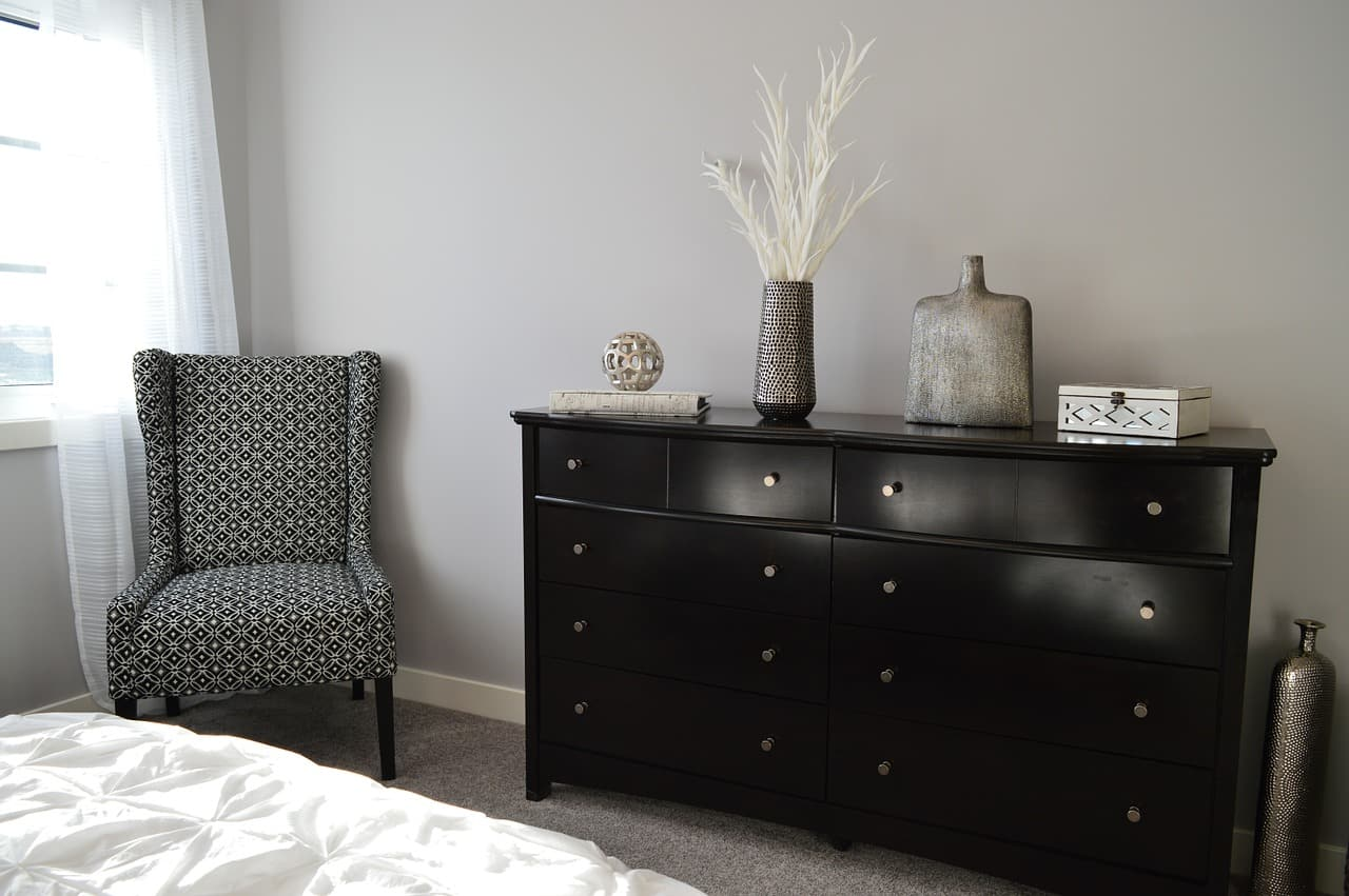 cBedroom with custom built cabinet and chair