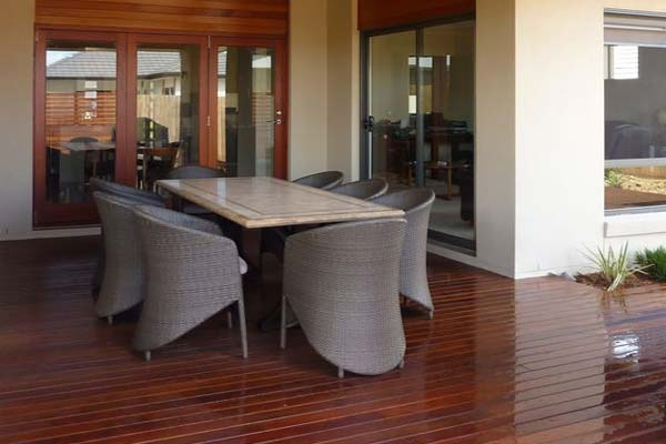 Roofed deck and stylish outdoor furniture