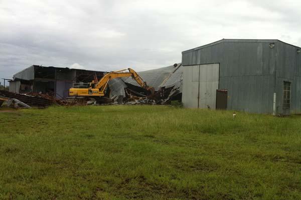 Tearing down a barn