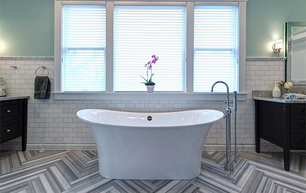 Herringbone floor tiled bathroom