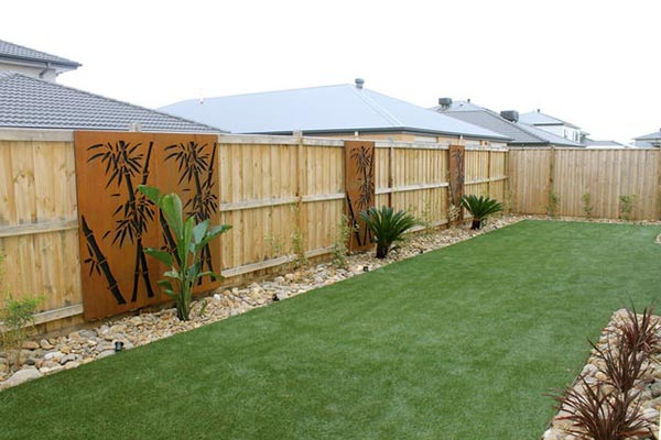Lawn grasses for landscaping with wooden fence.