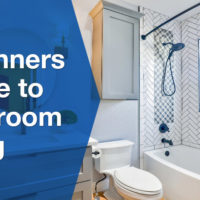 clean bathroom with oval mirror near toilet bowl