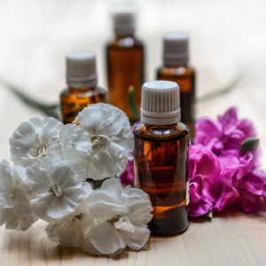 essential oils with white and purple petals