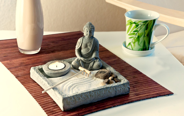 white table with buddhist statue