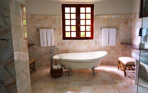 white bathtub on white tiles bathroom