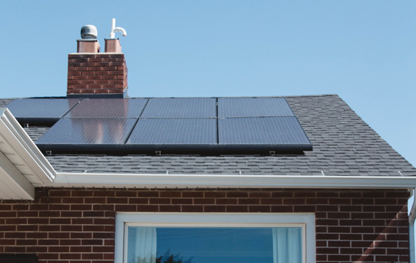 brown brick house with solar panel installed